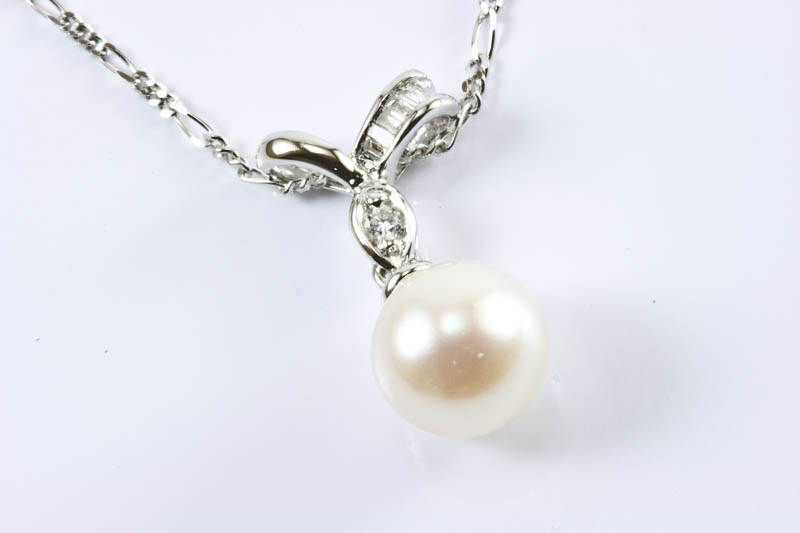 Akoya pearl, 18k white gold & diamond pendant